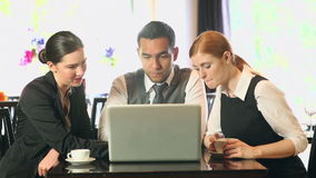 Business people working together while having coffee in a restaurant stock footage