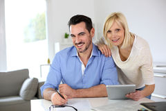 Business people working together at home Stock Images