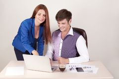 Business people working together on laptop computer.  Royalty Free Stock Images