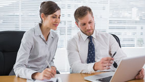 Business people working together with laptop. At desk in office Royalty Free Stock Photography