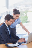 Business people working together with a laptop. In the office Royalty Free Stock Photos