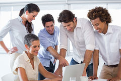 Business people working together on laptop. In the office Stock Photography