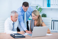 Business people working together on laptop. In the office Stock Photos