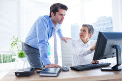 Business people working together on laptop Stock Images