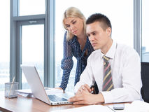 Business people working together on laptop in office. At desk Stock Photos