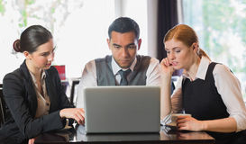 Business people working together with laptop. In restaurant Stock Photography
