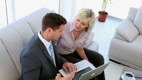 Business people working together on laptop. Sitting on sofa stock footage