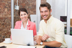 Business people working together on laptop and smiling Stock Photo