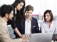 Business people working on a project. Business people working together at the office Royalty Free Stock Images
