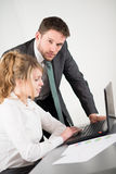 Business people working together in office with computer Stock Images