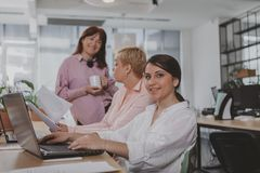 Business people working together at the office stock images