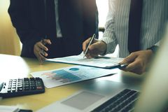 Business people working together at office room table and balancing budget.  royalty free stock photo