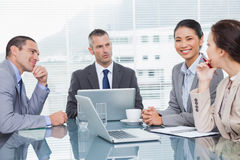 Business people working together over coffee Royalty Free Stock Photos
