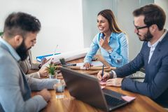 Business people working together on project in office Royalty Free Stock Images