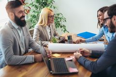 Business people working together on project in office Stock Photography