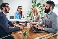 Business people working together on project in office Royalty Free Stock Photography