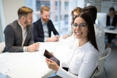 Business people working together on project and brainstorming in office stock images