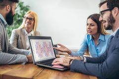 Business people working together on project in office Royalty Free Stock Photo