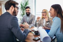 Business people working together on project in office Royalty Free Stock Image