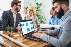 Business people working together on project in office Stock Images