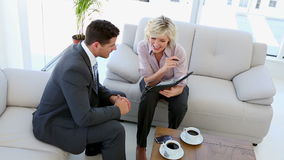 Business people working together. Sitting on sofa stock footage