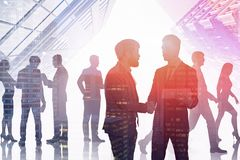 Business people working together, skyscrapers royalty free stock photography