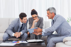 Business people working together on sofa Royalty Free Stock Images