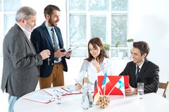 Business people working together. The business people working together at table. The meeting or summit concept Stock Photos