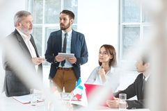 Business people working together. The business people working together at table. The meeting or summit concept Royalty Free Stock Photo