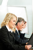 Business people - working in a workshop Stock Images