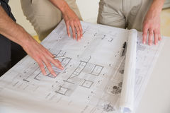 Business people wotking on blueprint Stock Photo