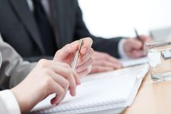 Business people writing Royalty Free Stock Photos