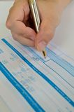 Business people writing the pen on deposit slip Royalty Free Stock Images