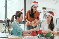 Business peopleexchange gift box in the office royalty free stock photo