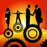 Business peoples on the cogwheel Royalty Free Stock Photography