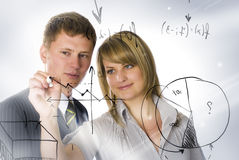 Business peoples drawing graphic. Two business peoples planing nwe graphic Stock Images