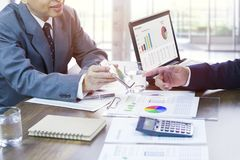 Business performance review and strategy planning. Businessmen in a meeting reviewing business performance and target planning for a new budget year royalty free stock photo