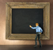 Business person against the blackboard Royalty Free Stock Images