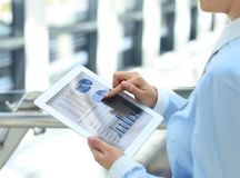 Business person analyzing financial statistics Royalty Free Stock Image