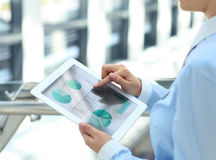 Business person analyzing financial statistics Stock Image