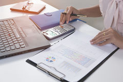 Business person analyzing financial statistics graph. On the paperwork Stock Photo