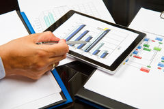 Business person analyzing graphs Stock Photo