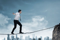 Business person balancing on the chain Royalty Free Stock Image