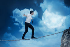 Business person balancing on the chain Royalty Free Stock Photo