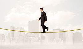 Business person balancing on golden rope Stock Photos
