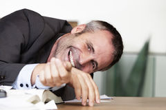 Business person being amuzed. Royalty Free Stock Image