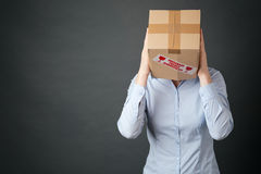 Business Person with Box Over Head Stock Photography