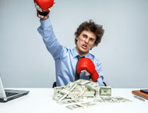 Business person boxing punching towards camera ready to fight Royalty Free Stock Photography