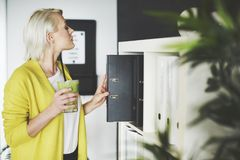 Blonde business woman in the office royalty free stock images