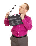 Business person with a clapperboard Royalty Free Stock Images